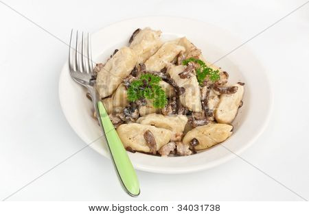 gnocchi with sausage and porcini mushrooms sauce