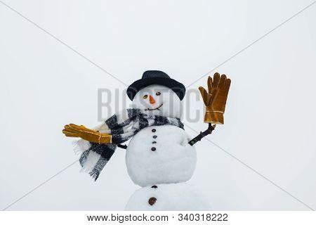 Happy Snowman In Winter. Wintertime. Christmas And Winter Fashion. Happy Snowman Waving In Hand. Hap