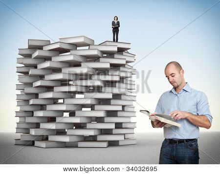 businesspeople and 3d book tower