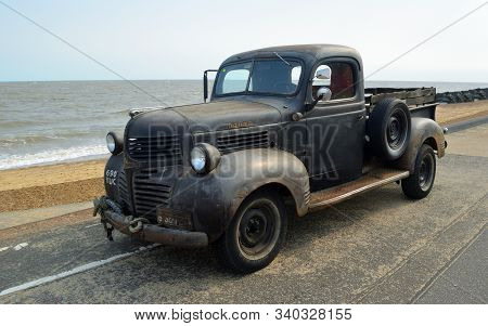 Felixstowe, Suffolk, England - August 29, 2015:  Rusty Classic Dodge Piick Up Truck  Parked On Seafr