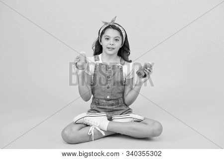 A Healthy Dieting For Kids. Small Girl Hold Bottles With Vitamin Nutrition. Little Child Enjoy Healt