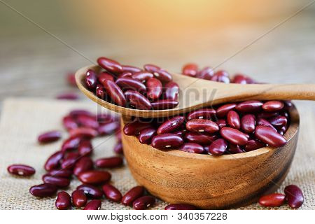 Red Bean In Wooden Bowl And Spoon On Sack Background / Grains Red Kidney Beans