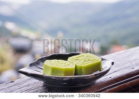 Delicious Green Mung Bean Cake With Black Tea Plate On Wooden Railing Of A Teahouse In Taiwan With B