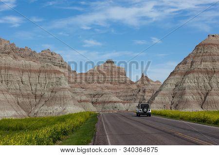 Badlands National Park, South Dakota - June16, 2014: A White Jeep Wrangler Driving On A Paved Road I