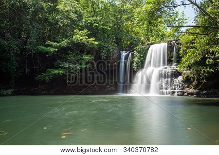 The Waterfall In The Hill Behind A Pond In Jungle, Long Explosure Technique Photography