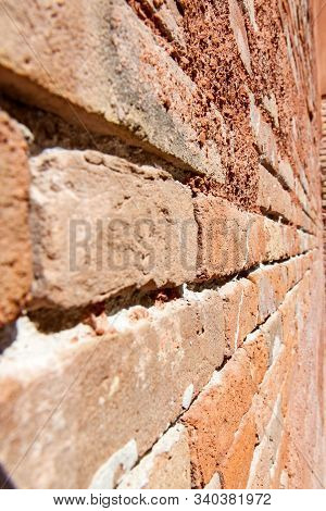 Old Red Bricks In Wall In Venice