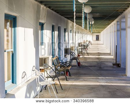 Death Valley Junction, Usa - July 19, 2008: Gallery And Patio With Chairs In Front Of The Rooms Of A