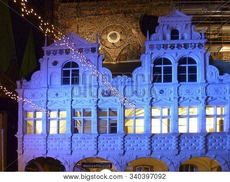 Luebeck, Germany - Jan 2, 2010: Facade Of Townhall In Luebeck By Night Illuminated In Blue.