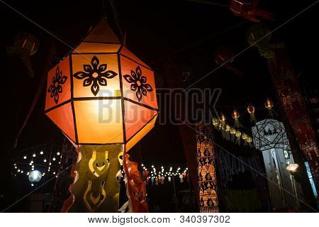 Orange Paper Lanterns In Loi Krathong Festival On Left Frame. Lanterns Contest In Loi Krathong Festi