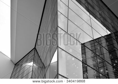 Sun Rays Light Effects On Urban Buildings In Sunset. Modern Office Building Detail, Glass Surface Wi