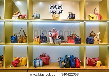 BERLIN, GERMANY - CIRCA SEPTEMBER, 2019: MCM bags on display at the Kaufhaus des Westens (KaDeWe) department store in Berlin. MCM Worldwide is a leather luxury goods brand founded by Michael Cromer.