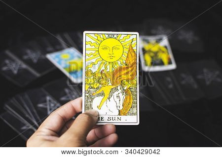Rayong Province,thailand - December 16 2019, The Sun Card Tarot In A Left Hand Of Fotune Teller For