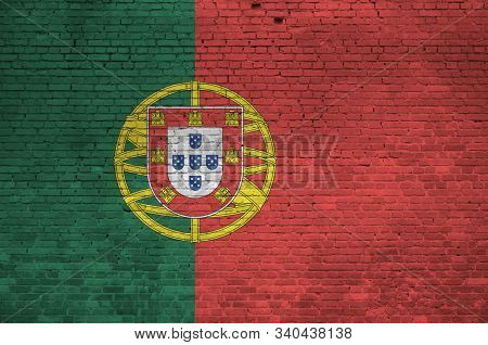 Portugal flag depicted in paint colors on old brick wall. Textured banner on big brick wall masonry background poster