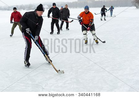 Dnipro, Ukraine - January 28, 2018: Group Of Active Different Aged People Playing Hokey On A Frozen