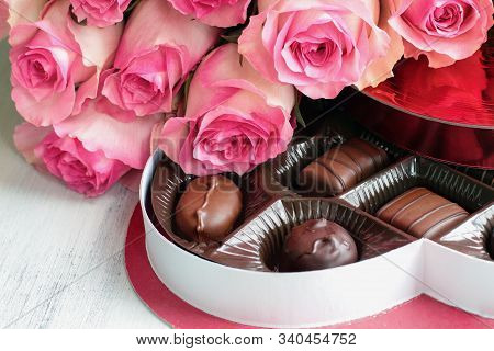 Dozen Soft Long Stem Pink Rose Flowers With A Heart Shaped Box Of Chocolate Candy For Valentine Day