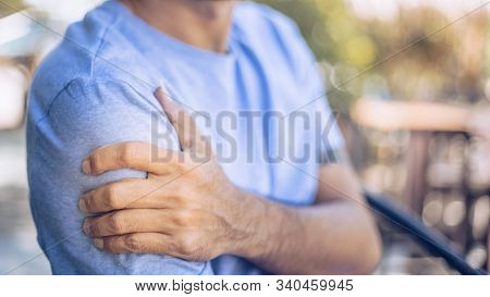Young Man With Pain In Shoulder And Upper Arm ,health Care Concept