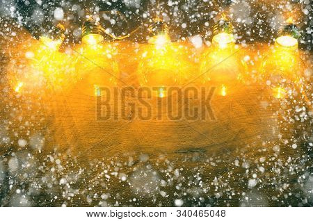 Christmas Background With Garland Light And Snow
