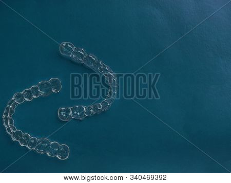 Invisible Dental Teeth Brackets Tooth Aligners On Trendy Blue Background, Plastic Braces Dentistry R