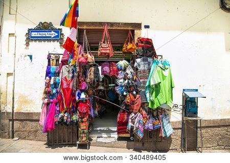 Cusco , Peru- Jan 9, 2019:  Colourful goods for sale in a souvenir shop in the historic city of Cusco in Peru,
