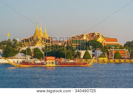 The Golden Grand Palace With The Royal Barge Procession For The Thai King On Chao Phraya River Near