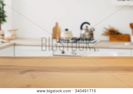 Wooden Board Empty Table In Front Of A Blurred Background. Perspective Brown Wood With A Blurred Bac