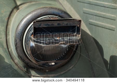 Round Headlight Of A Military Car With Blackout Headlight Cover On It, Old-timer Vehicle From Wwii P