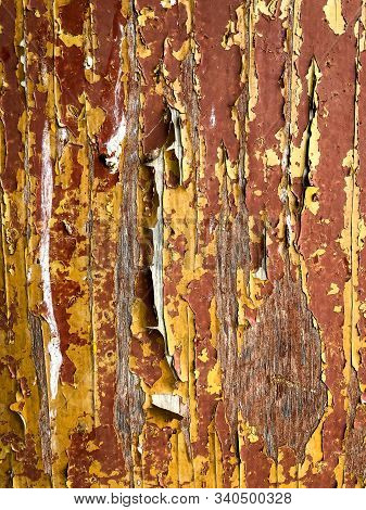 Peeling Yellow And Brown Paint On Old Building
