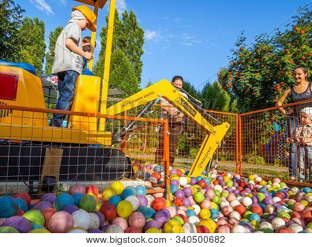 Voronezh, Russia - July 15, 2019: A Child Plays On The Attraction
