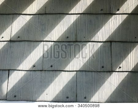 Diagonal Light And Dark Shadow Pattern On Old Wooden Shingles