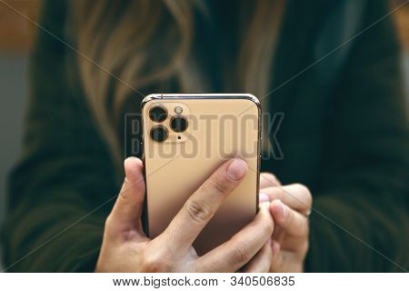 Turkey, Istanbul, December 17, 2019: The Girl Uses The New Modern Iphone 11 Pro Max With Three Camer