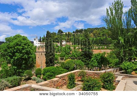 GRANADA, SPAIN - MAY 19: Gardens of La Alhambra with the Generalife in the background on May 19, 2012 in Granada, Spain. La Alhambra is UNESCO World Heritage Site since 1984