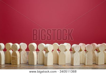 A Crowd Of Wooden Figures Of People. Society, Demography. Customers And Buyers, Statistics, Preferen