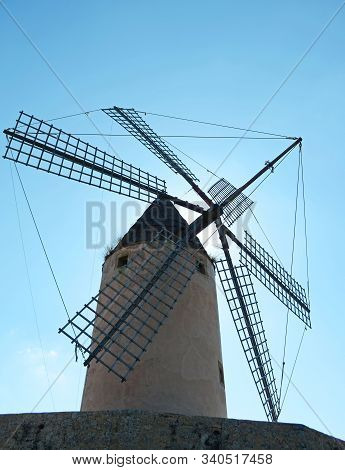 Windmill Backlight In Mallorca. Balearic Islands.nice Backlight View Of A Windmill, On The Blue Back