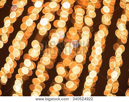 Illuminated Garlands Of Lights Beautiful Bokeh. Festive Background. Bright Christmas Street Illumina