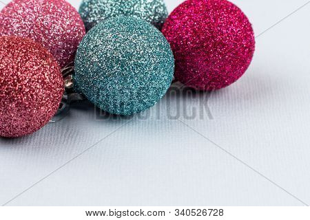 Christmas Tree Colored Balls Lie On A Light Background