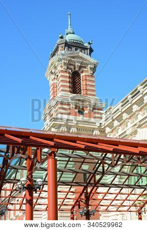 NEW YORK, NY - 04 NOV 2019: Closeup detail  of the Entrance canopy and tower atop the Main Building at Ellis Island National Museum of Immigration.