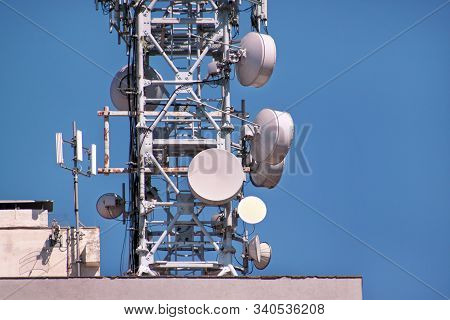 Telecommunication Base Stations Network Repeaters On The Roof Of Building. The Cellular Communicatio
