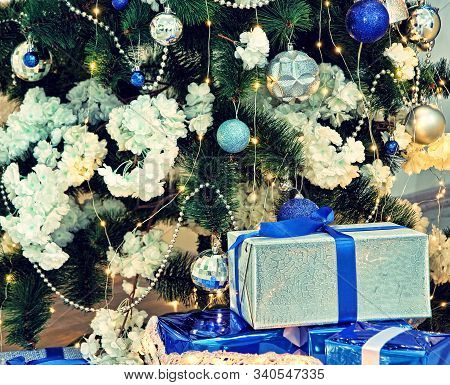 New Year. Christmas. Christmas Fir-tree And Christmas Gifts Taken Closeup.