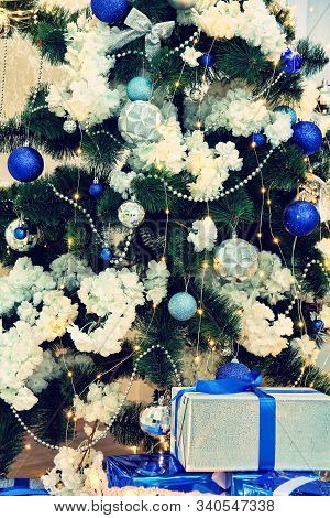 Christmas Fir-tree, Christmas Decorations And Gifts Taken Closeup. New Year. Christmas.