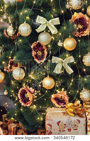 New Year. Christmas. Christmas Fir-tree, Golden Christmas Decorations And Gifts Taken Closeup.