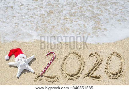 2020 Year Beach Background Near Ocean With Starfish In Santa Hat And Christmas Balls