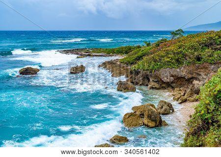 Beautiful Tropical Caribbean Island Landscape View. Scenic Summer Vacation Ocean Coast Cliffs Settin