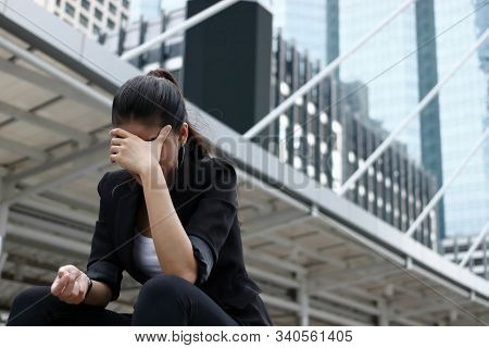 Unemployed Stressed Young Asian Business Woman In Formal Cloathes Covering Face With Hands. Failure