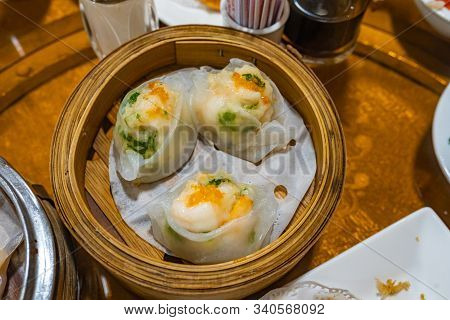 Colorful Steamed Stuffed Shrimp And Chives Dumplings In Dimsum Restaurant