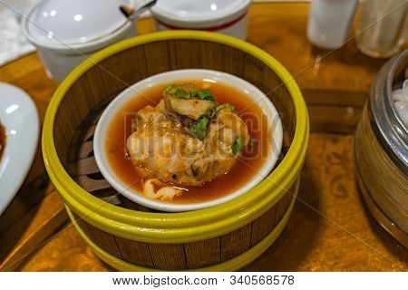 Chinese Steamed Meat Ball And Sauce In Dimsum Steamer Box