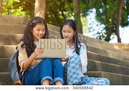 Students Young Asian Together Reading Book Study Smiling With Tablet,laptop Computer At High School