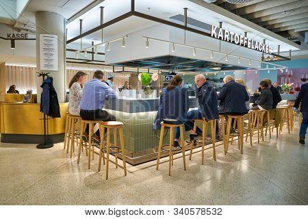 BERLIN, GERMANY - CIRCA SEPTEMBER, 2019: people sit at Kartoffelacker at the Kaufhaus des Westens (KaDeWe) department store in Berlin.