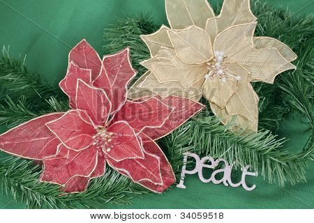 Poinsettias With Greenery On A Green Background