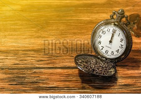 Luxury Vintage Black Pocket Watch On Wooden Table, Abstract For Time Concept With Copy Space, Sepia