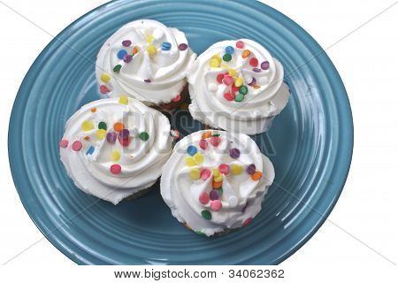 Four Cupcakes On Turquoise Plate